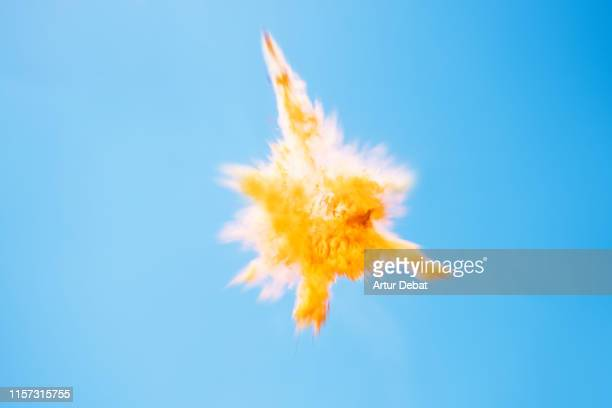 beautiful yellow powder explosion in the sky. - energy drink stock pictures, royalty-free photos & images