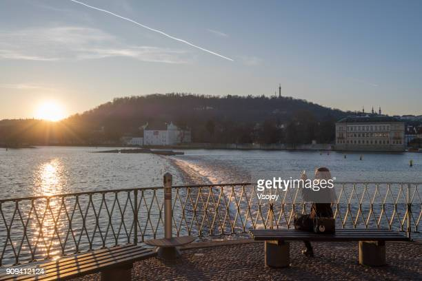 a beautiful yound woman capturing the moment on sunset, prague, czech republic - vsojoy stock pictures, royalty-free photos & images