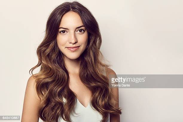 beautiful young adult with long wavy brown hair