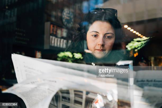 Beautiful Young Adult Woman Reading Newspaper