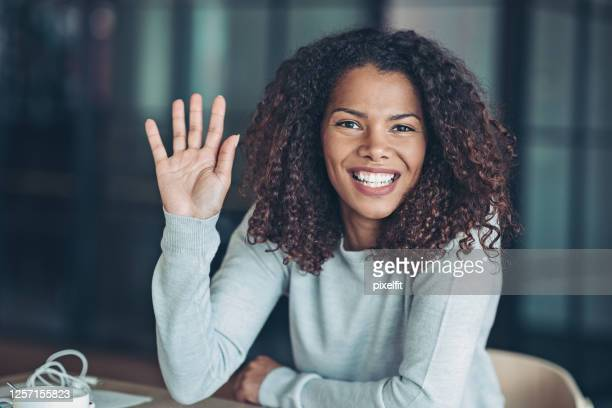 beautiful young african ethnicity woman - greeting stock pictures, royalty-free photos & images
