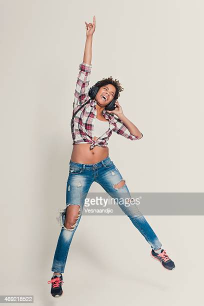 Beautiful young African woman jumping