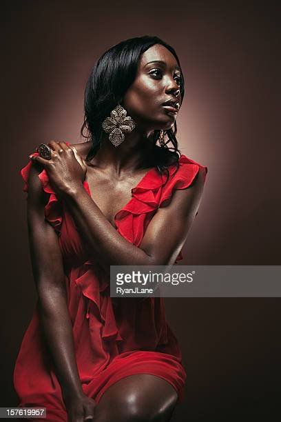 beautiful young african woman - metallic dress stock pictures, royalty-free photos & images