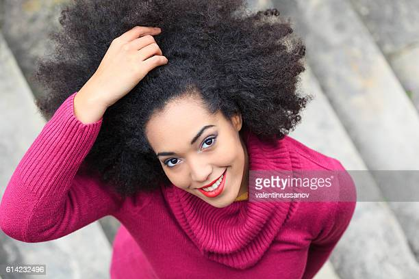 Beautiful young african woman standing on stairs