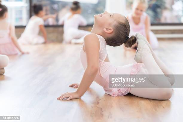 beautiful young ballet dancer warms up before class - little girls dressed up wearing pantyhose stock photos and pictures