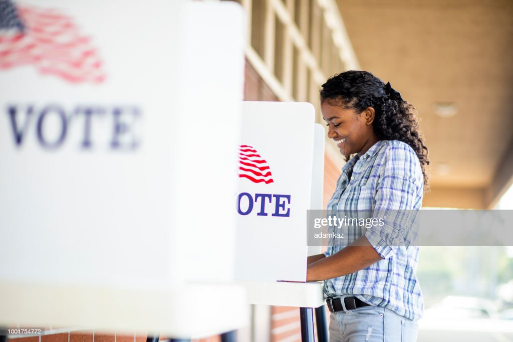 Beautiful Young Black Girl Voting : Stock Photo