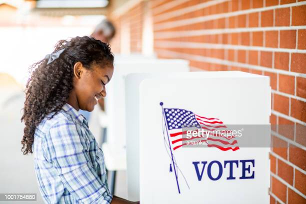 beautiful young black girl voting - american influenced stock photos and pictures