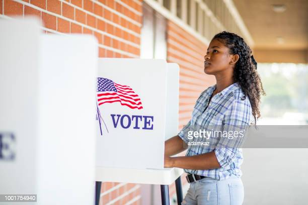 beautiful young black girl voting - democratic party stock pictures, royalty-free photos & images