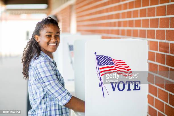 beautiful young black girl voting - black civil rights stock pictures, royalty-free photos & images
