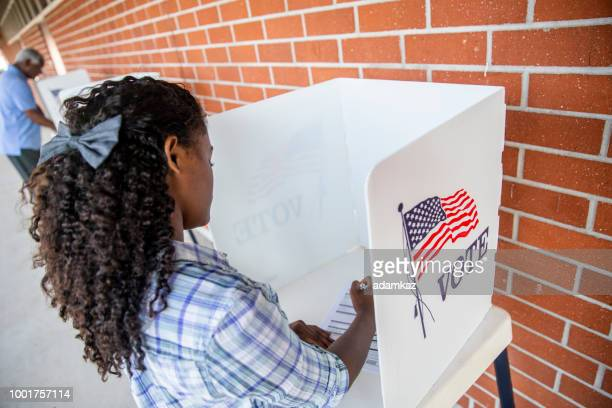 beautiful young black girl voting - ballot box stock pictures, royalty-free photos & images