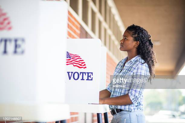 beautiful young black girl voting - voting stock pictures, royalty-free photos & images