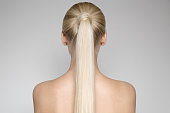 Beautiful Young Blond Woman With Ponytail Hairstyƒle. Back view