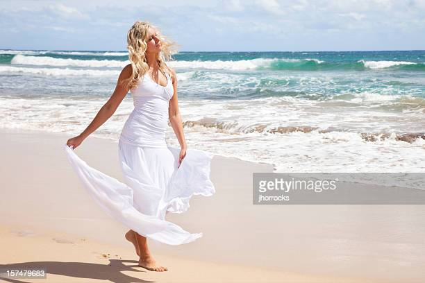 beautiful young blonde woman on hawaiian beach - wind blows up skirt stock pictures, royalty-free photos & images