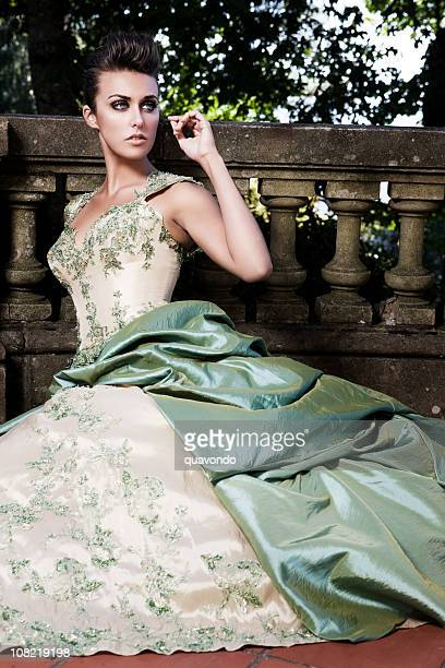 beautiful sophisticated fashion model in evening gown at castle - historical clothing stock pictures, royalty-free photos & images