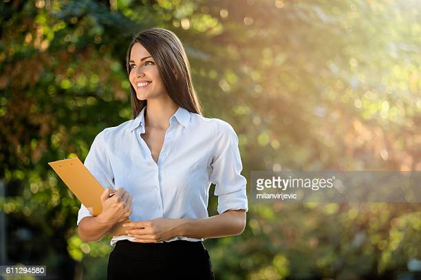 beautiful young businesswoman in the park - social grace stock pictures, royalty-free photos & images