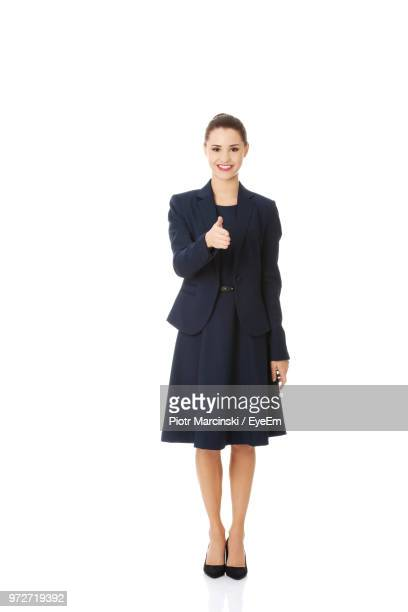 beautiful young businesswoman standing against white background - 若い女性だけ ストックフォトと画像