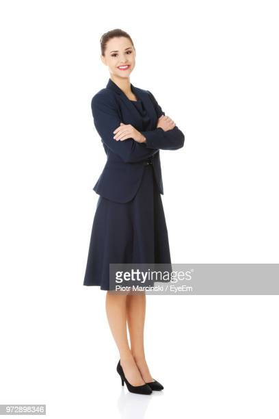 beautiful young businesswoman standing against white background - only young women stock pictures, royalty-free photos & images