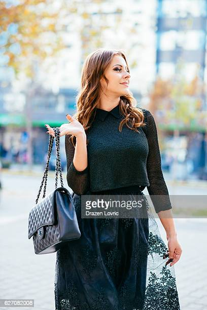 beautiful young caucasian woman in elegant clothing - clutch bag stock pictures, royalty-free photos & images