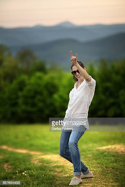 Beautiful young Caucasian woman with arm raised