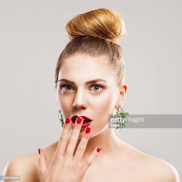 Beautiful young chic woman in shock