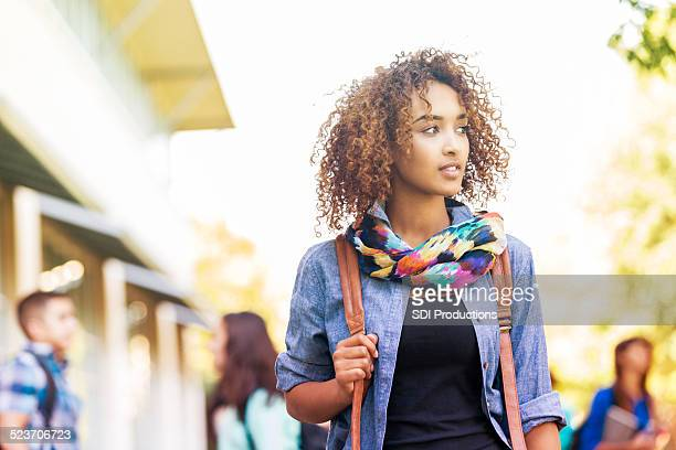beautiful young college girl walking outdoors on campus - beautiful ethiopian girls stock photos and pictures
