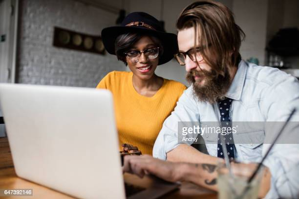 Beautiful young couple browsing for vacation destinations