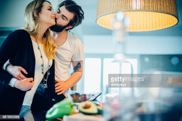 Beautiful young couple cooking together healthy meal