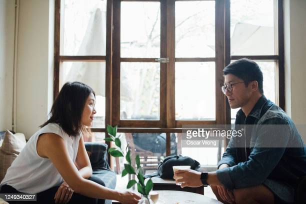 beautiful young couple dating at cafe - dating stock pictures, royalty-free photos & images