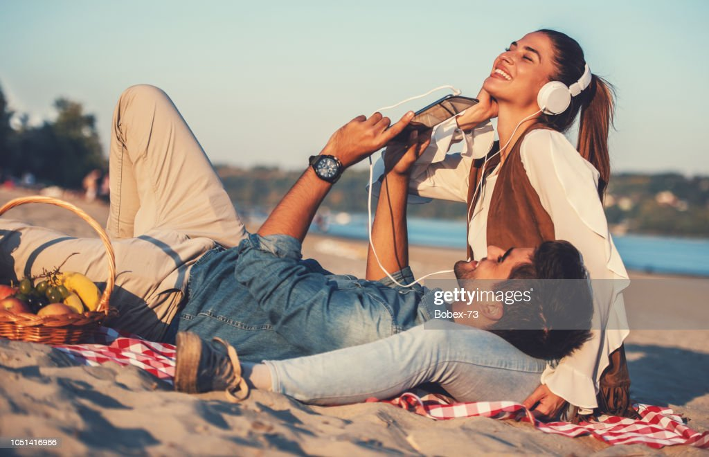 Beautiful young couple having fun on the beach. Lifestyle, love, dating, vacation concept : Stock Photo