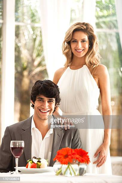Beautiful young couple in the restaurant.
