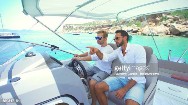 beautiful young couple relaxed in yatch - rich garcia stock-fotos und bilder