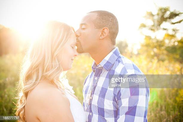 beautiful young couple together outdoors - black men kissing white women stock photos and pictures