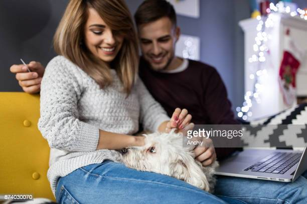 Beautiful young couple with their dog at home