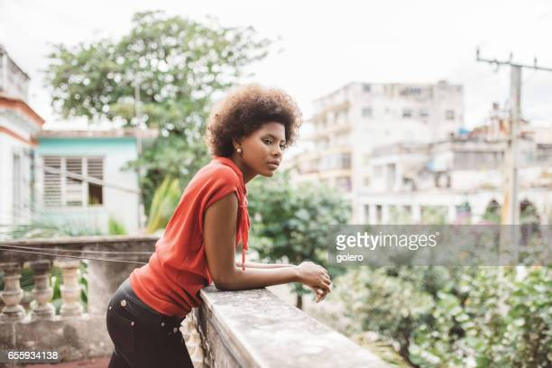 beautiful young cuban woman on balcony in Havanna
