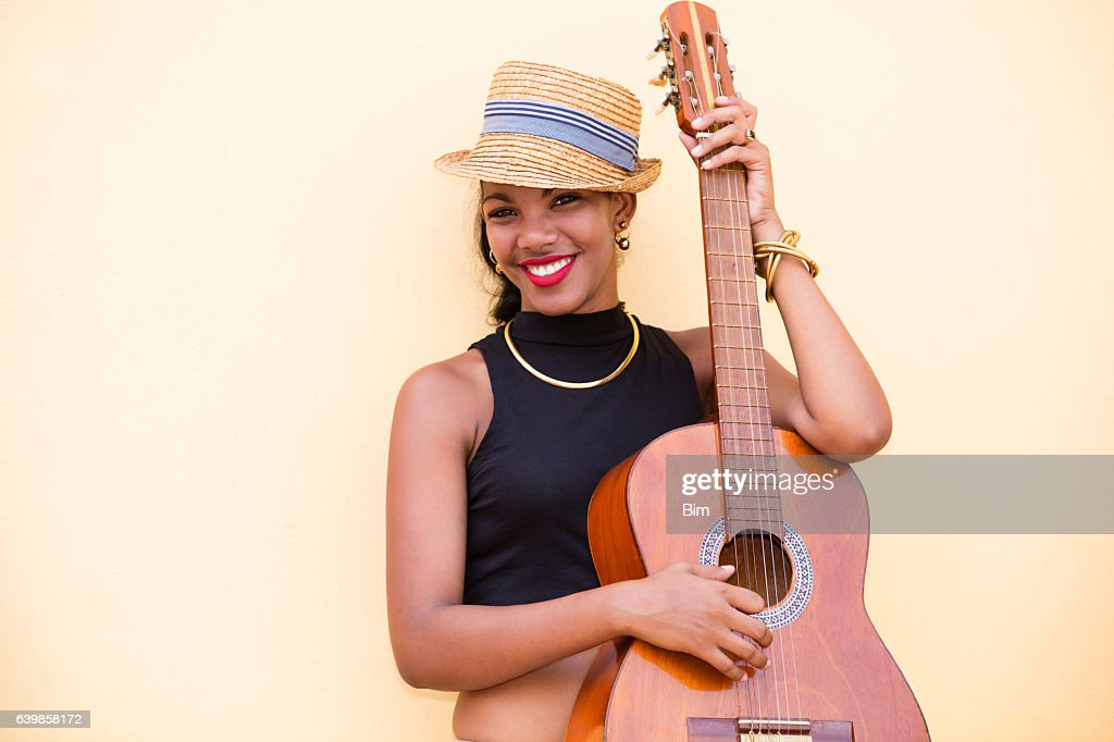 Beautiful young Cuban woman with guitar, Havana, Cuba : Stock Photo