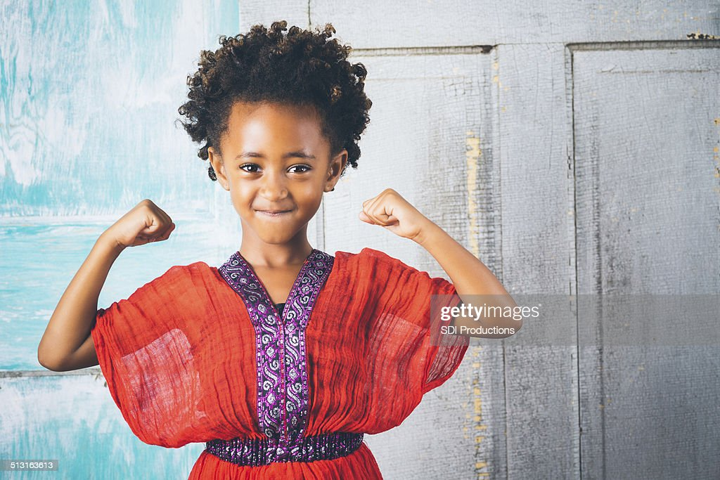 Beautiful Young Ethiopian Girl In Traditional Clothing Showing Strength Stock Photo -9094