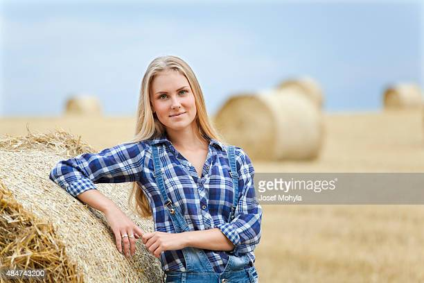 Beautiful young farmer on field
