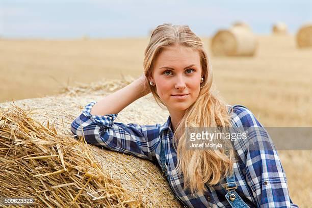 Beautiful young farmer on field