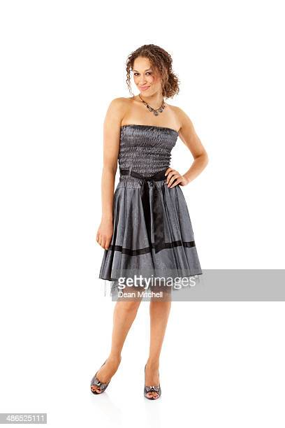Beautiful young female model posing in stylish dress