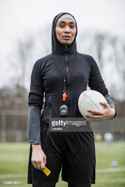 beautiful young female muslim referee - referee stock pictures, royalty-free photos & images