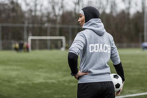 Beautiful Young Female Muslim Soccer Coach 1208376119