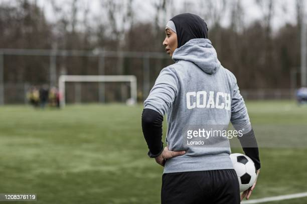 beautiful young female muslim soccer coach - manager stock pictures, royalty-free photos & images