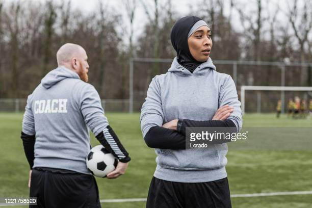 beautiful young female muslim soccer player and coach - coach stock pictures, royalty-free photos & images