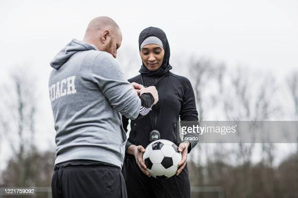 beautiful young female muslim soccer player and coach - sportsperson stock pictures, royalty-free photos & images