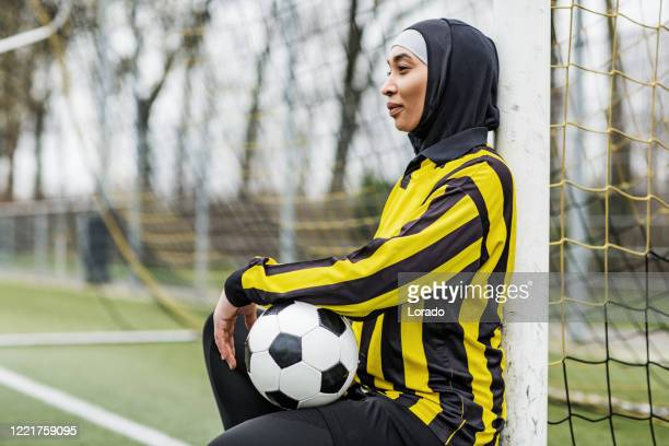 beautiful young female muslim soccer player - veil stock pictures, royalty-free photos & images