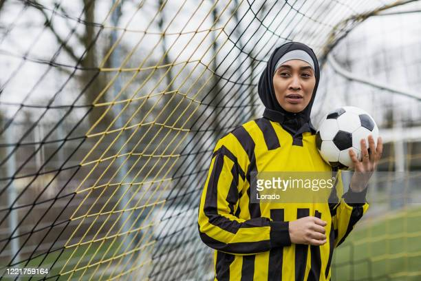 beautiful young female muslim soccer player - football player stock pictures, royalty-free photos & images