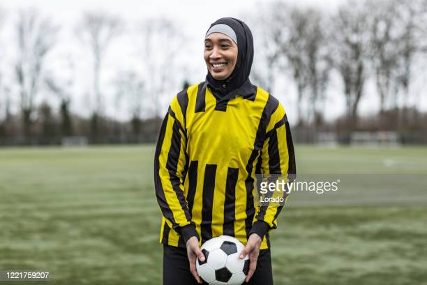 beautiful young female muslim soccer player - football stock pictures, royalty-free photos & images