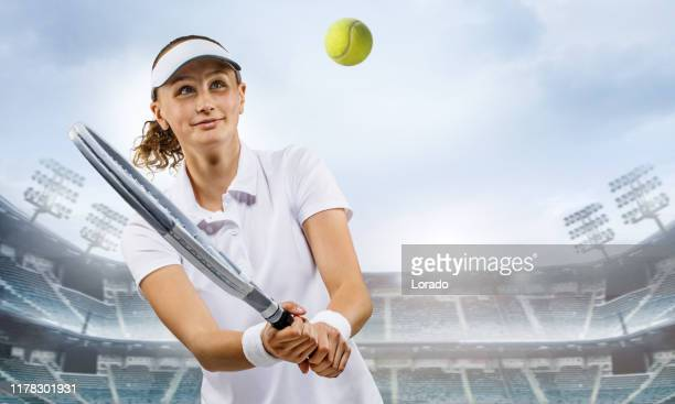 beautiful young female tennis player in a fictional stadium - tennis tournament stock pictures, royalty-free photos & images