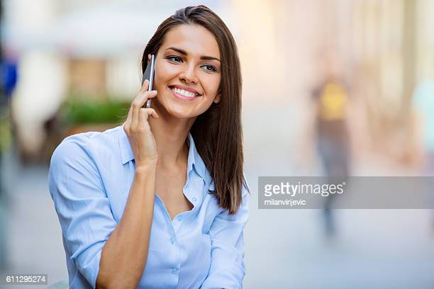 beautiful young female using smartphone - social grace stock pictures, royalty-free photos & images
