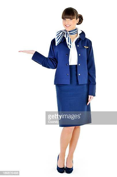 Beautiful young flight attendant welcome